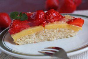 Fresh strawberreis on custard and sponge cake